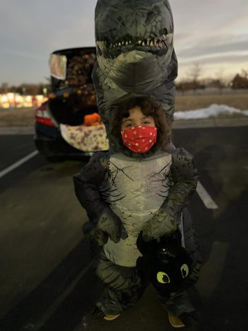 Six year old Anneliese Barwick, attending the Light of the World Church trunk or treat event while safely dressed up as the famous T-rex.
